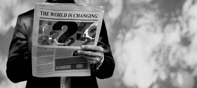 muž s novinami